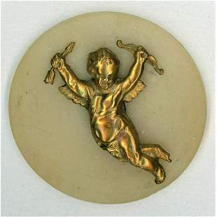 A LATE 19TH CENTURY BRASS CUPID ON EARLY CELLULOID