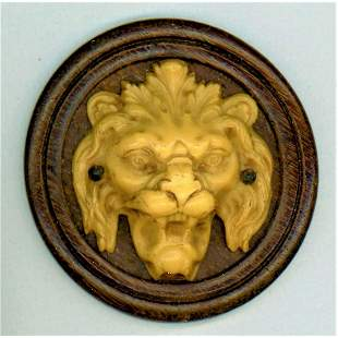 A RARE DIVISION ONE IVOROID LION BUTTON