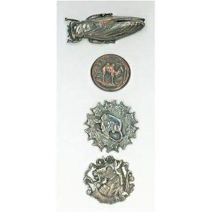 A SMALL CARD OF ASSORTED METAL ANIMAL BUTTONS
