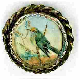 A DIVISION 1 HAND PAINTED UNDER GLASS BLUEBIRD BUTTON