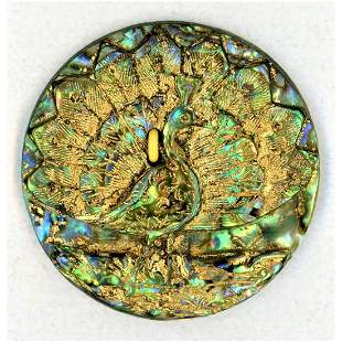 A RARE DIVISION ONE CARVED ABALONE SHELL PEACOCK BUTTON