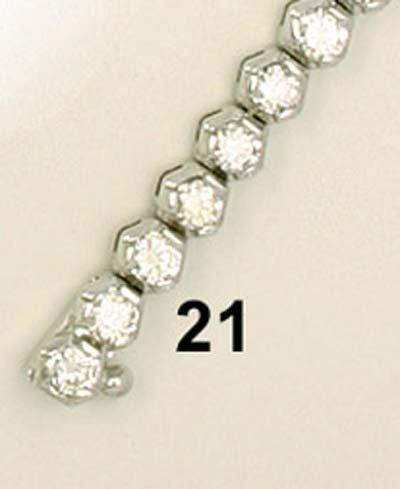 21: Tennisarmband WG 750/000,  ca. 50 Brillanten zus. 4
