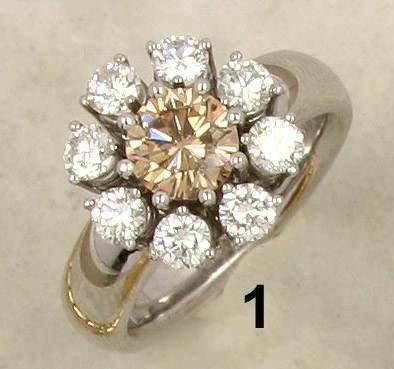 1: Ring WG 750/000, mittig brauner Brillant 1,06 ct. v/
