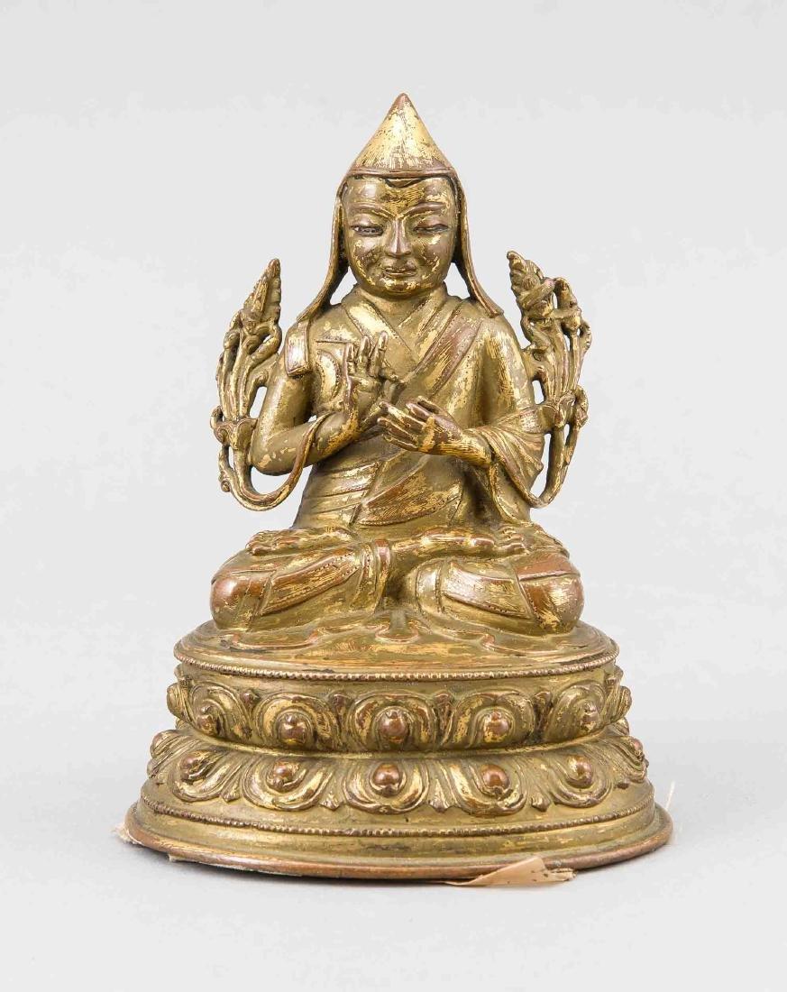 A gilt bronze figure of Tsongkhapa, Sino-Tibetan.
