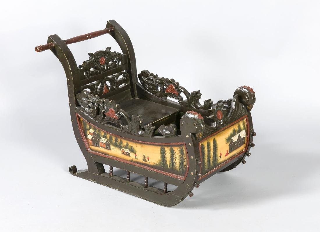 An early 20th-cenrtury child´s sleigh, wood polychromed
