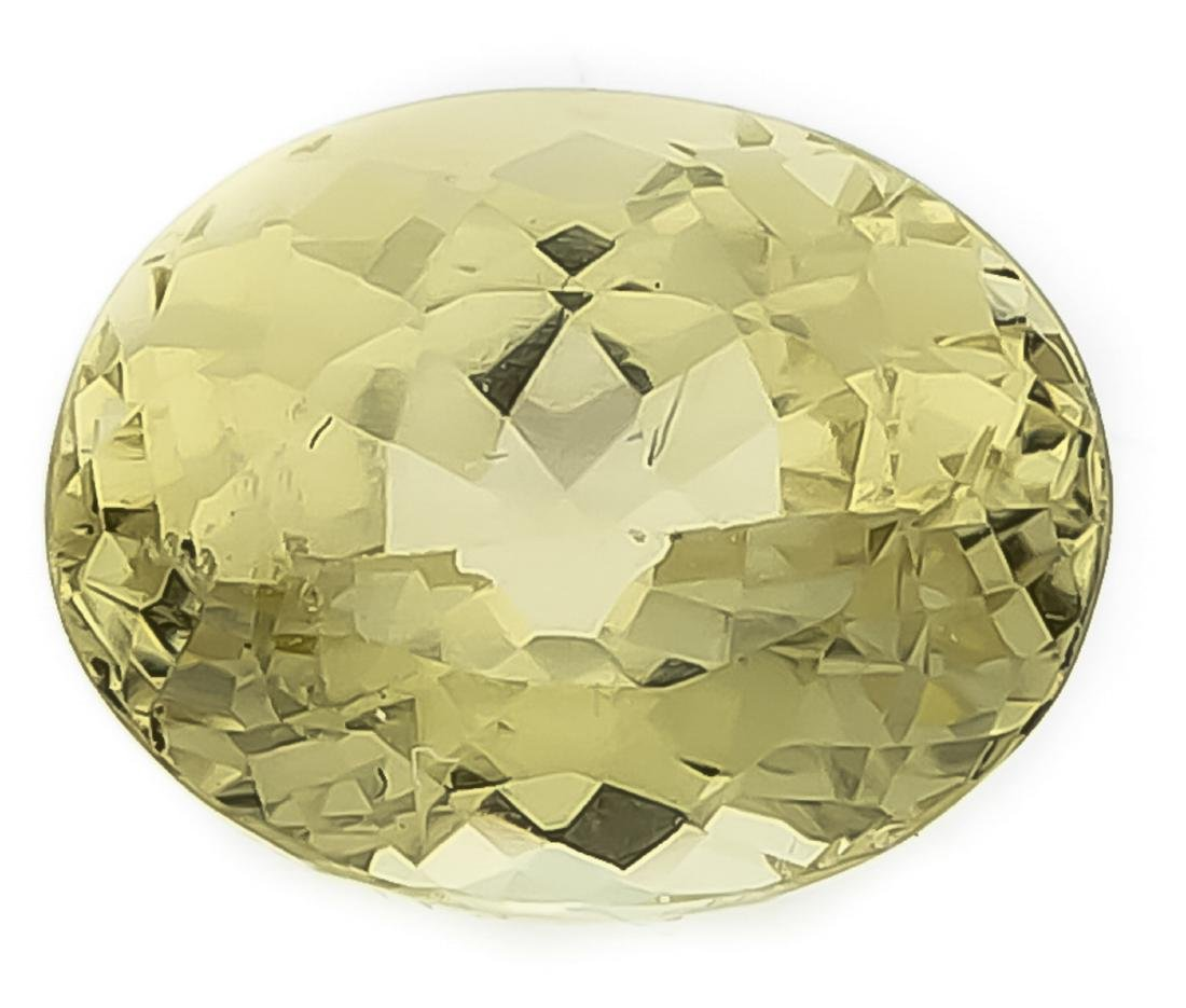 Chrysoberyl 2.75 ct, oval fac., in a yellowish green,