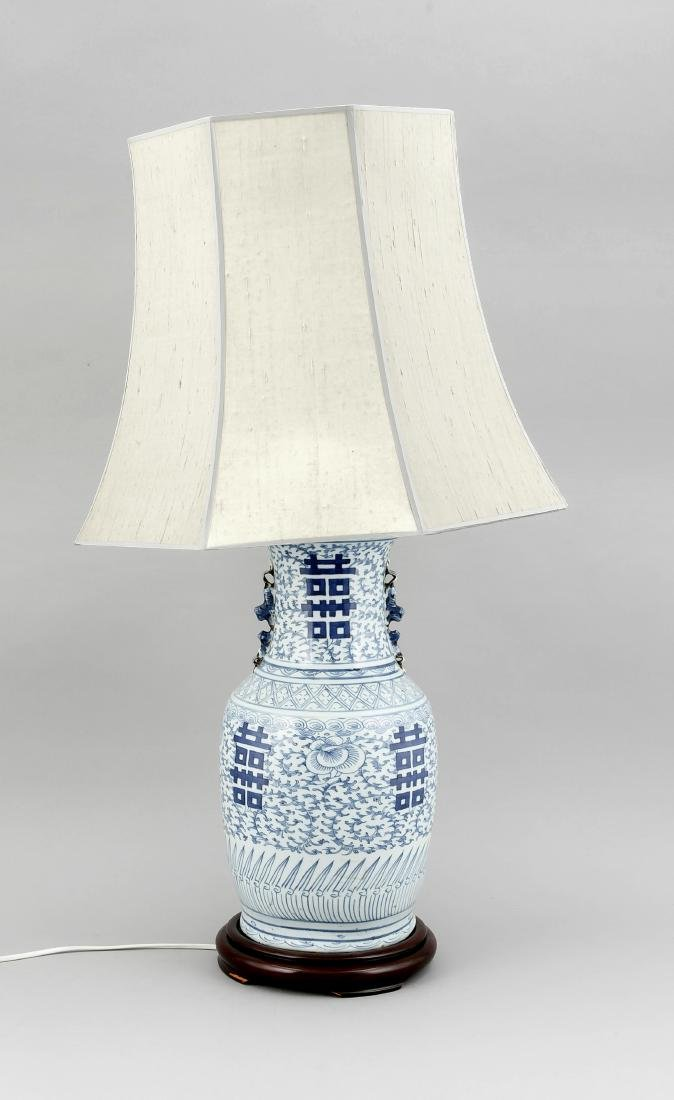 A 19th-century Chinese blue and white vase mounted as
