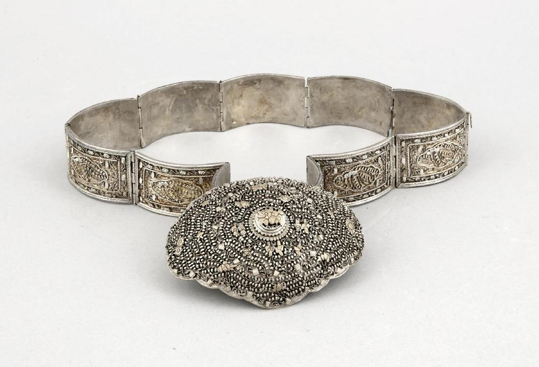 A 20th-century Asian belt, plated, with relief and