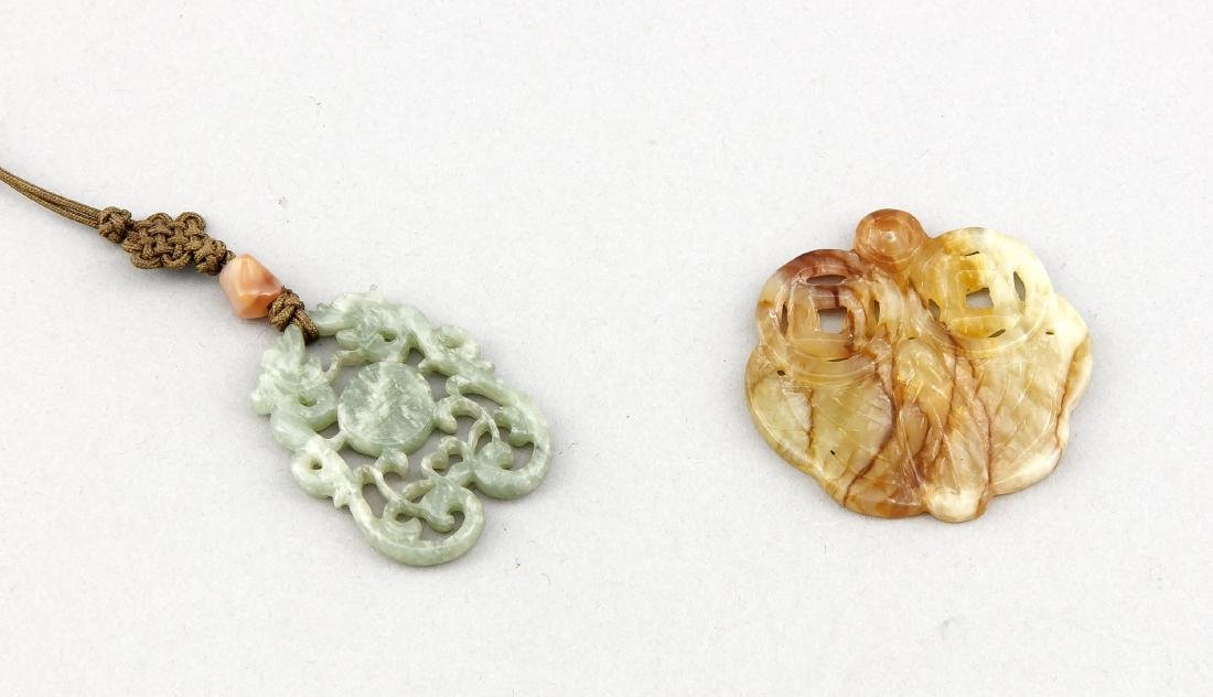 Two jade charms, one of seladon-colour with central
