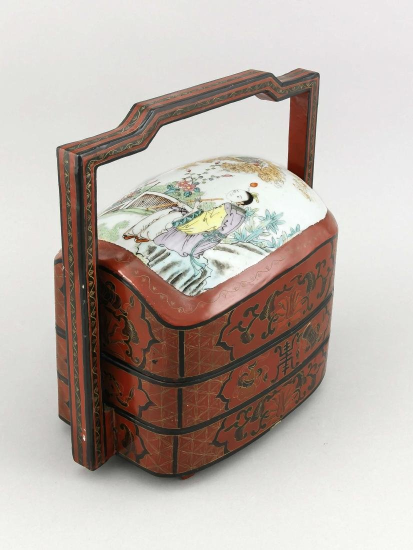 A 19th-century Chinese lunch pail, wood with red