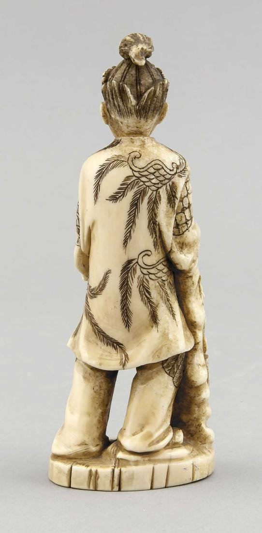 A 19th-century Japanese okimono, ivory carved, with - 2