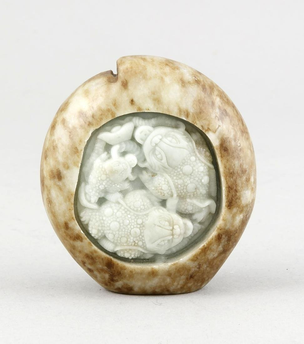 A Chinese jade carving, 19th c., seladon-coloured jade