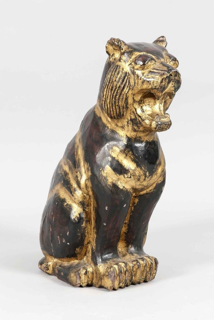 Cowering lioness, Asia, 20th c., dark asian wood, rest