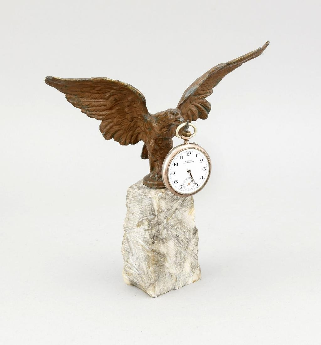 Pocket watch holder in the shape of an eagle, circa