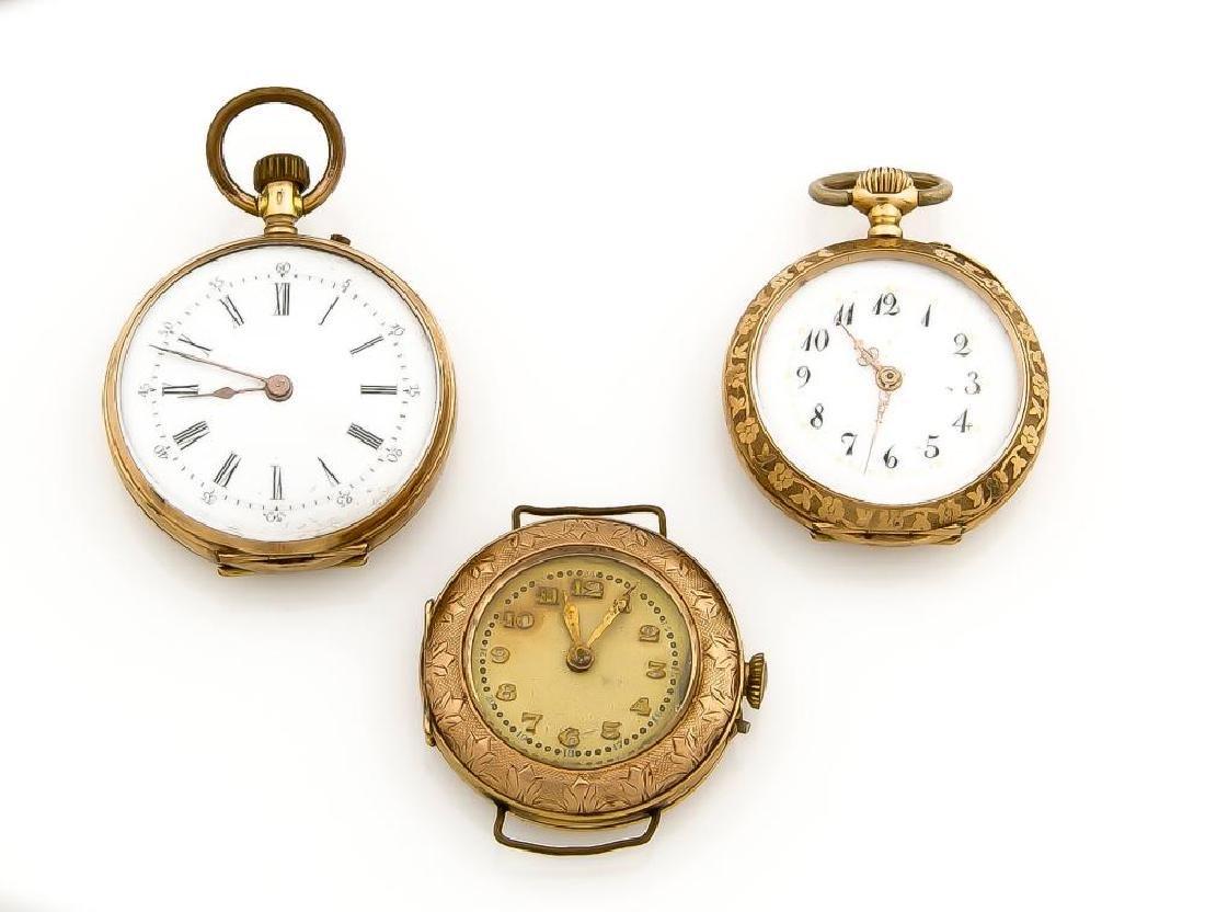 Konvolut 2 TU, eine Armbanduhr, 585 Gold,