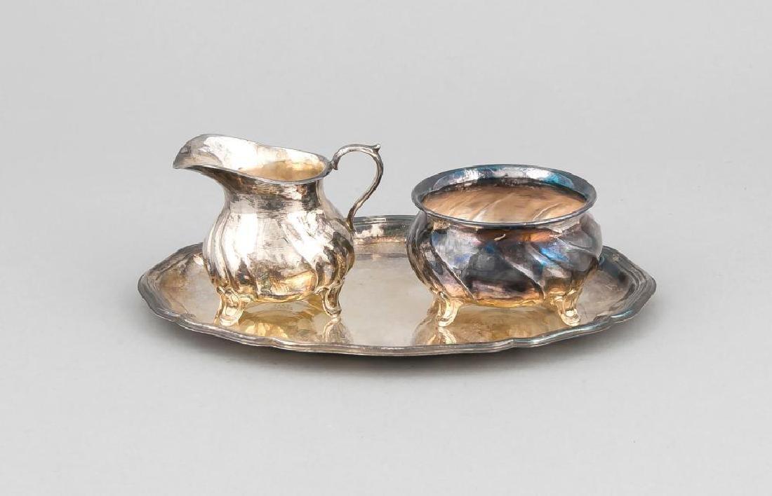 Cream and sugar jar on oval tray, German, 20th cent.,