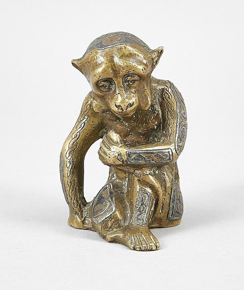 Figur eines sitzenden Aff