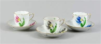 Three demitasse cups with saucers