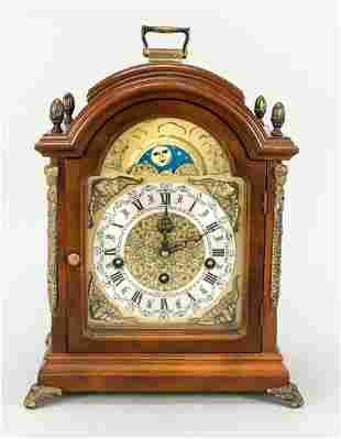 Table clock, 20th c., oak, gilded h