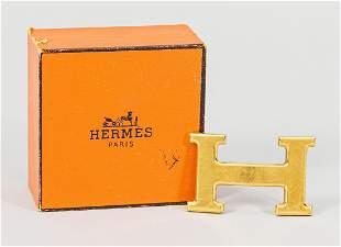 Belt buckle by Hermès, golden ''H''