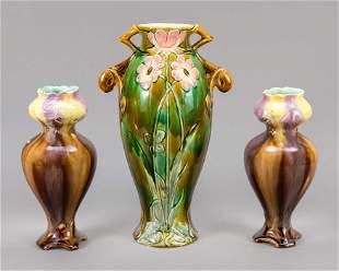 Three ceramic vases, beginning