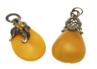 2 antique amber pendants with