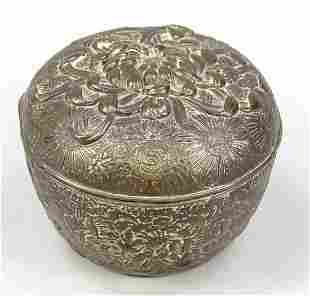 Lidded box with relief decor
