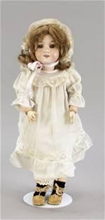 Porcelain head doll by Armand
