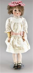 Porcelain head doll by Simon &
