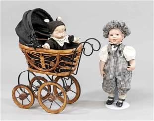 2 porcelain dolls in doll carr