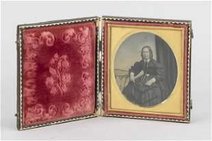 Portrait photograph in casket