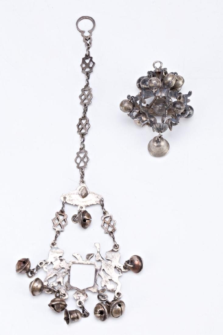 Two silver rattle pendants, late 18th Century  Silver.