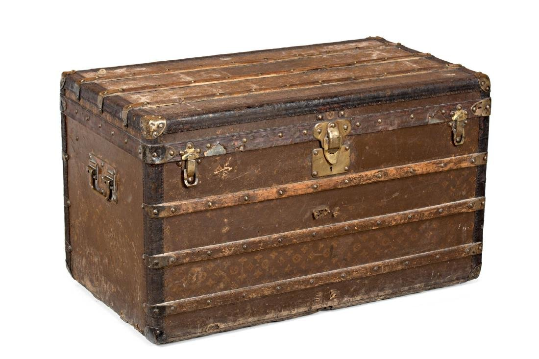 Louis Vuitton trunk in leather and wood with brass