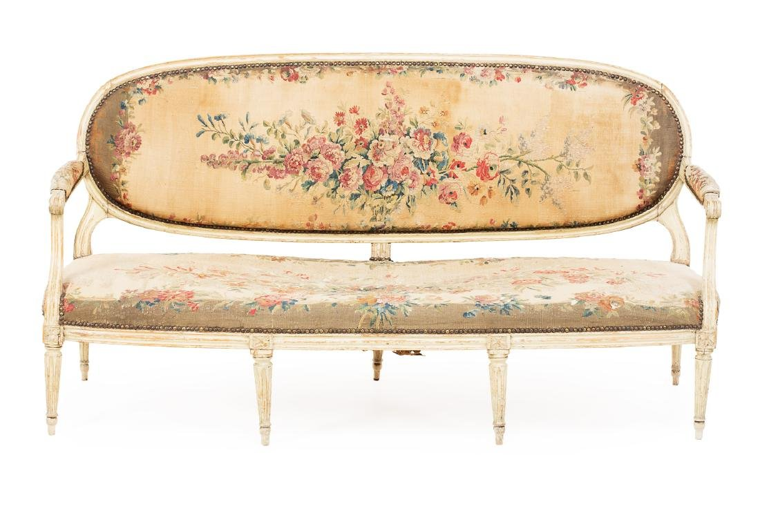 French Louis XVI sofa in white-lacquered wood,