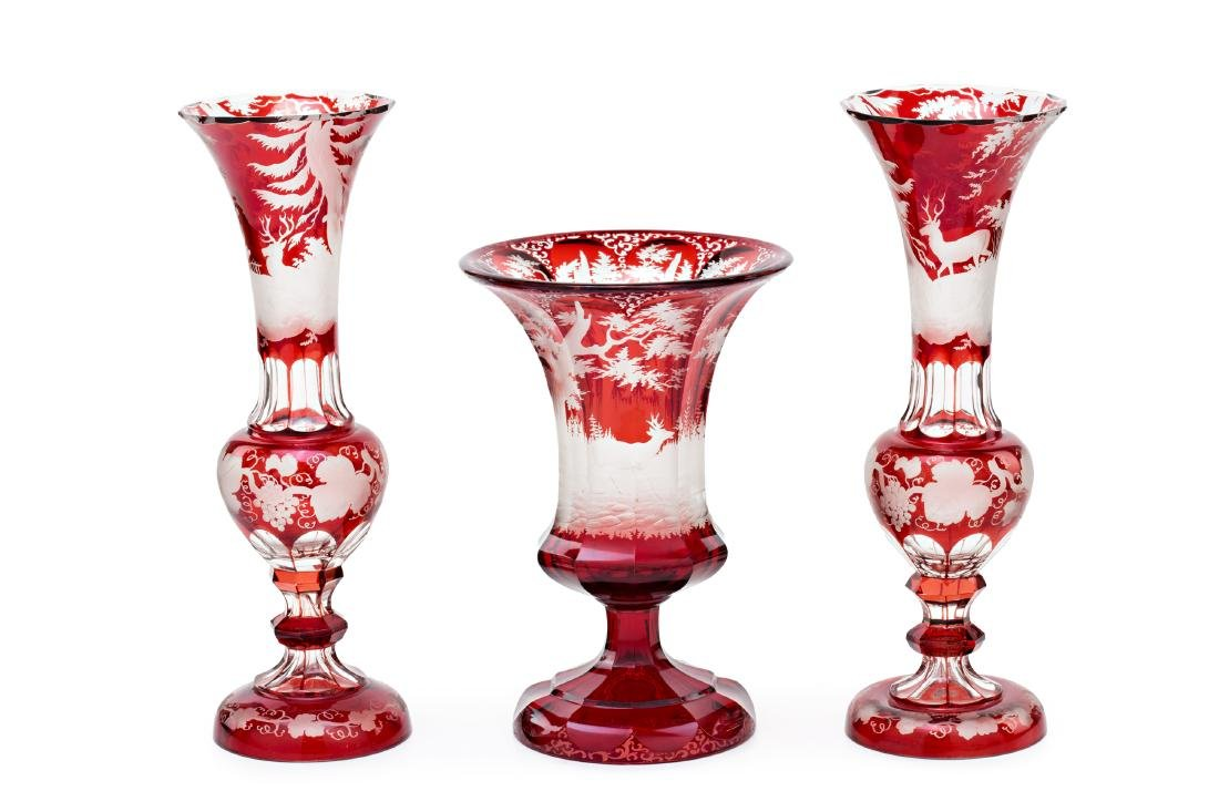 Pair of vases and vase in ruby red and carved Bohemia