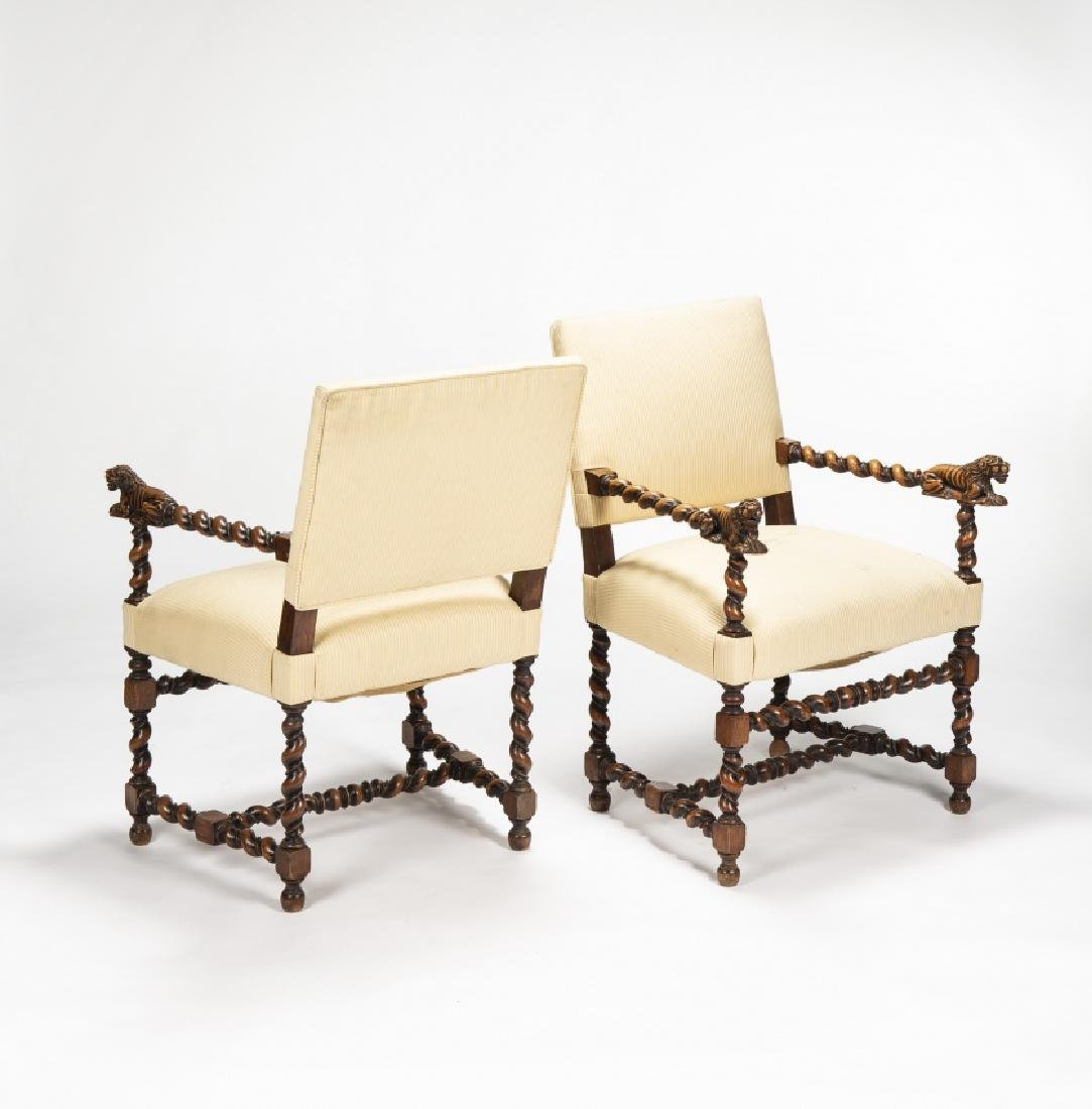 Pair of Louis XIII armchairs in carved and moulded oak,