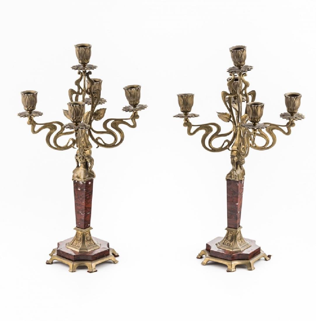 Pair of French Art Nouveau candelabra in gilt bronze