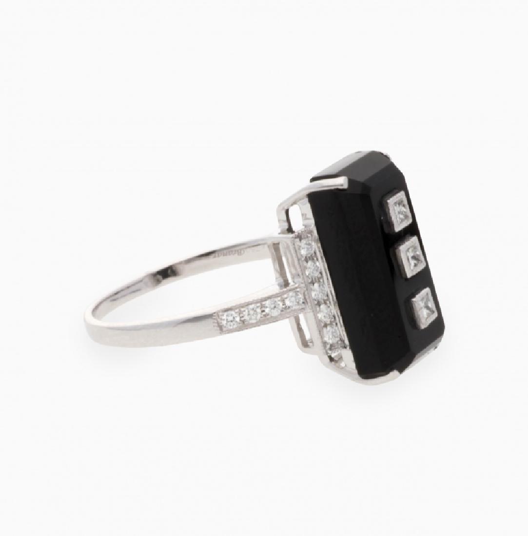 Onyx and diamonds ring