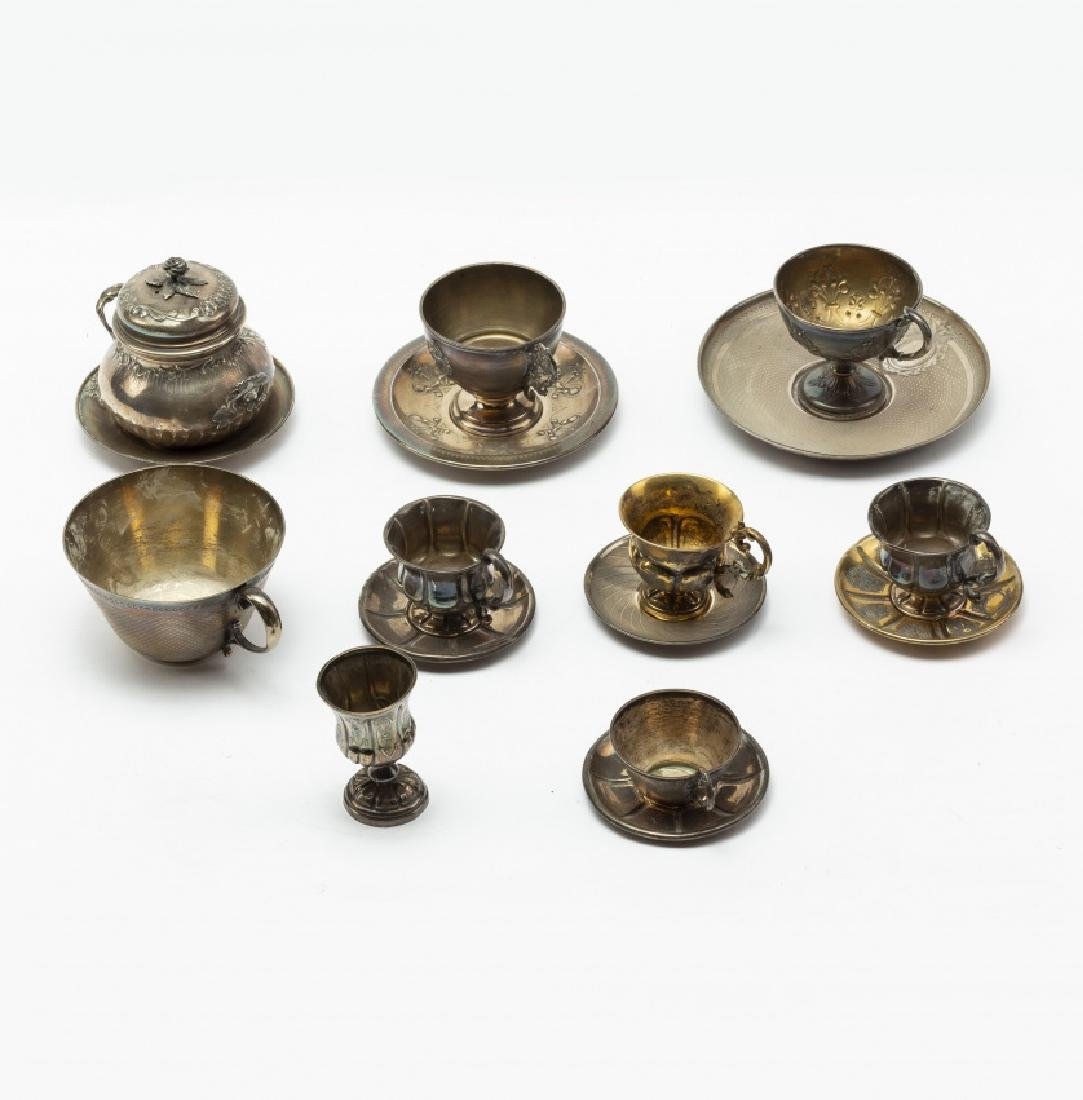 Six French cups with their saucers and a Cordoban cup