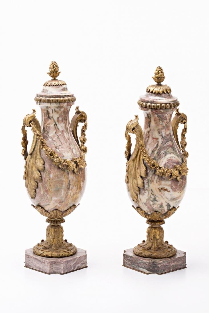 Pair of Louis XVI style French goblets in rose marble