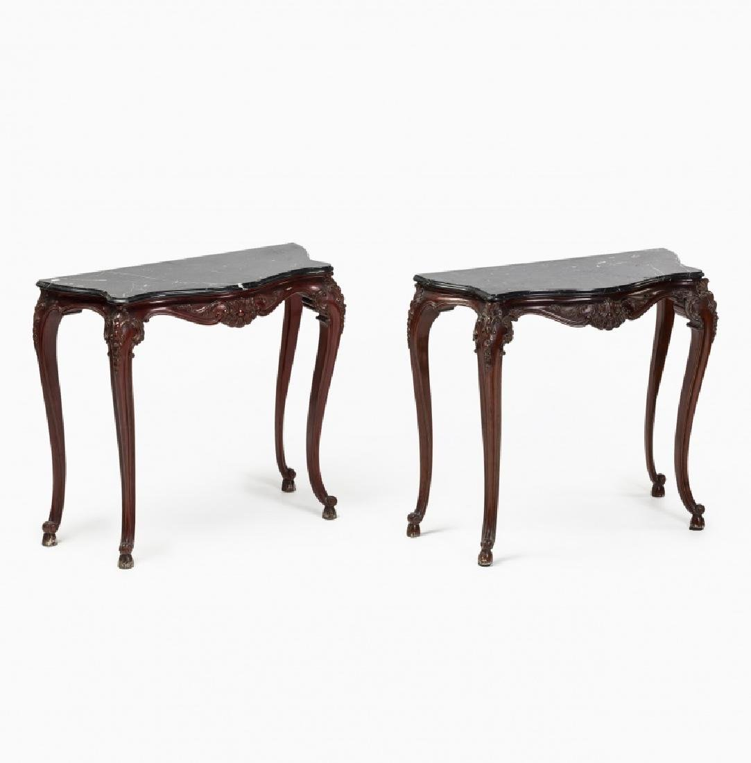 Pair of Louis XV style consoles in carved mahogany,