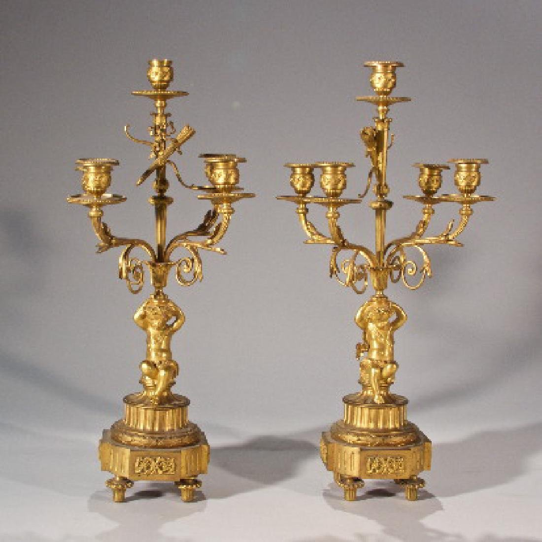 Pair of French Dore Bronze Cupid Candelabra