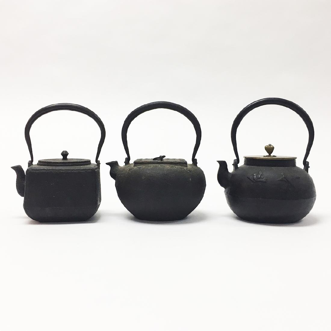 Three Asian Iron Teapots