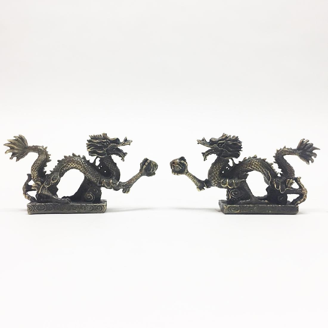A Pair of Chinese Bronze Dragon Ornaments