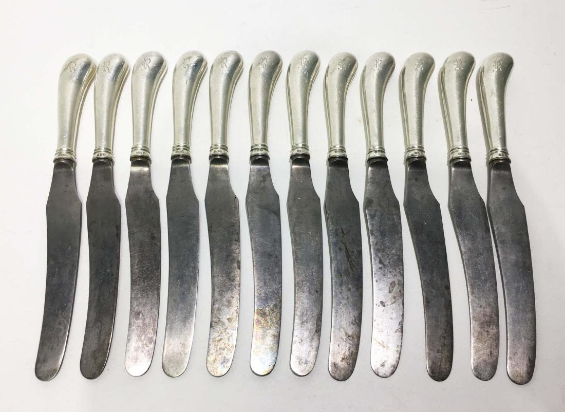 A Set of Twelve English Silver Knives