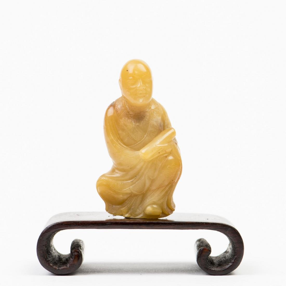 A SHOUSHAN FIGURINE WITH BASE