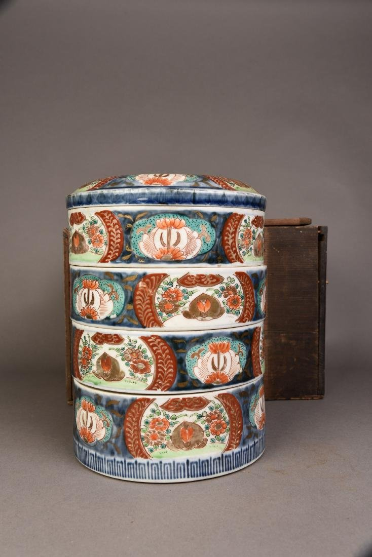 A SET OF FOUR PORCELAIN BOXES WITH COVER