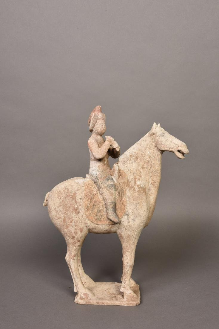 A SCULPTURE OF A MAN RIDING ON A HORSE