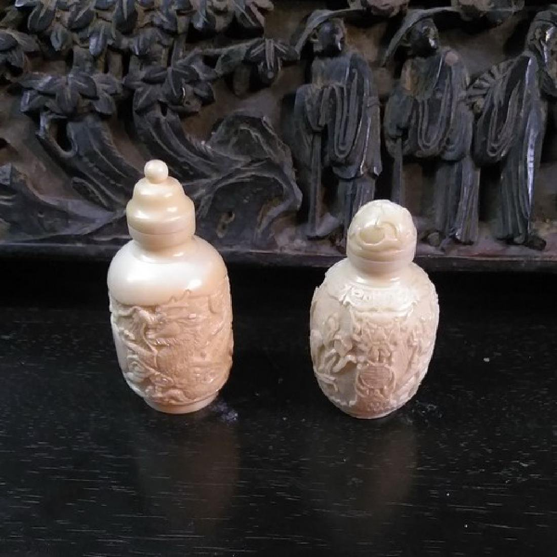 Pair of Collectible Chinese Bone Snuff Bottles w.