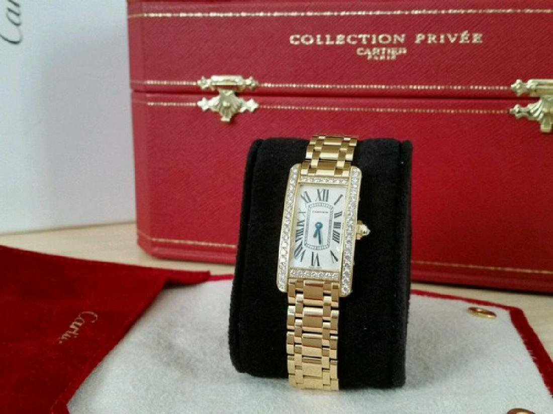 Cartier Watch ( Tank in 18K Yellow Gold w. Diamonds)
